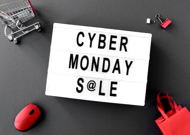 Top view of cyber monday light box with mouse and bags