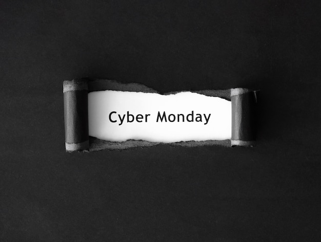 Top view of cyber monday with ripped paper