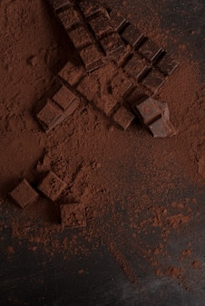 Top view of dark chocolate blocks crashed into pieces