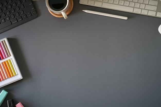 Top view dark grey workspace with office gadget and copy space