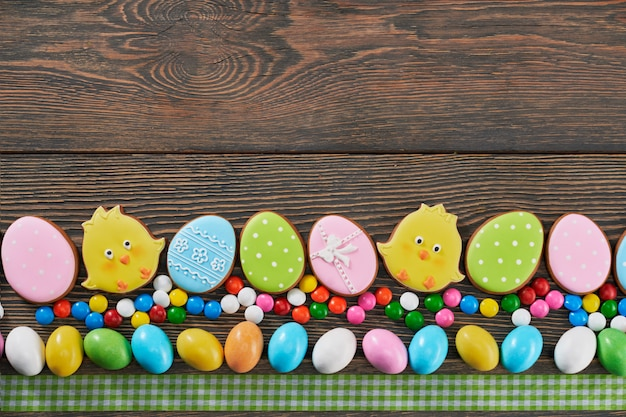 Top view of decorated easter cookies on wooden background
