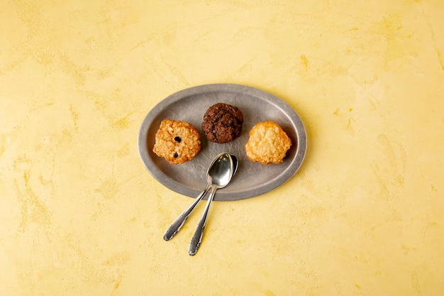 Top view decoration with cookies and yellow background
