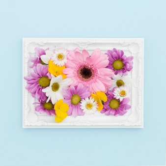 Top view decoration with flowers in a frame