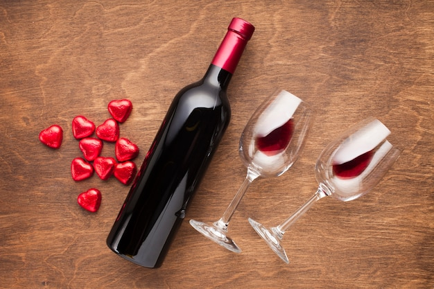 Top view decoration with heart shaped candies and wine