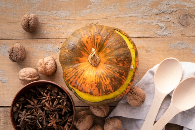 Top view decoration with pumpkin and wooden background