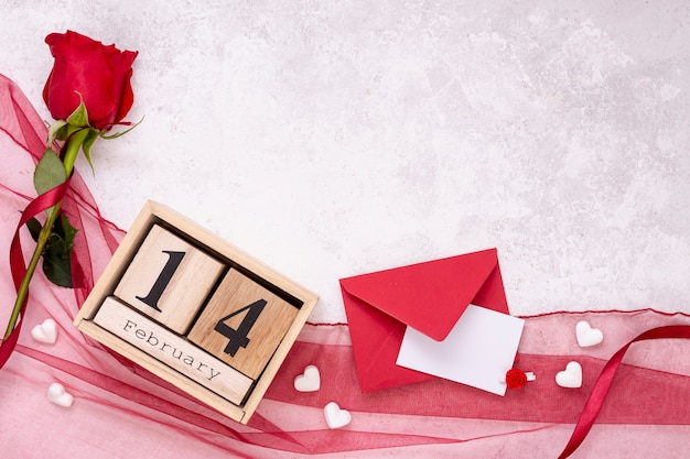 Top view decoration with rose and envelope