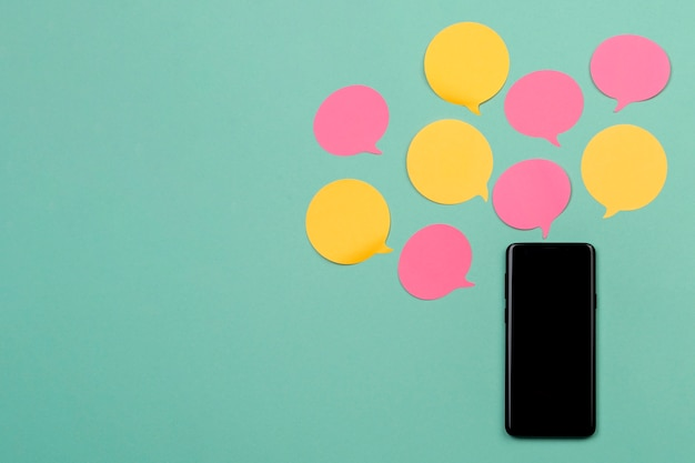 Top view decoration with smartphone and sticky notes