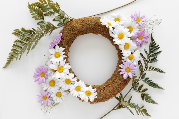 Top view of decorative elegance wreath with green leafs on white background