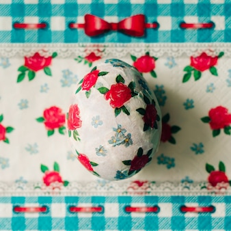 Top view decoupage easter egg decorated with paper napkins
