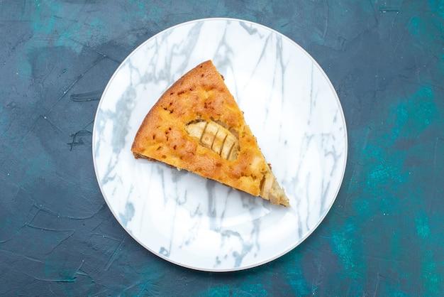 Top view delicious apple pie sliced inside plate on dark-blue background fruit cake pie sugar sweet