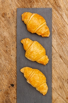 Top view delicious baked croissants