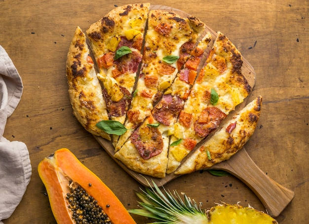 Top view of delicious baked pineapple and papaya pizza