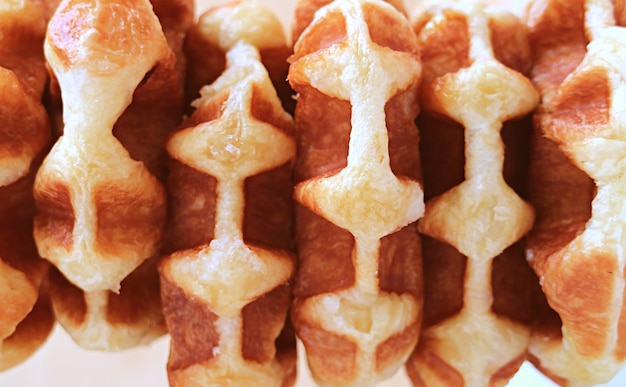 Top view of delicious belgian liege waffles in row for background or banner