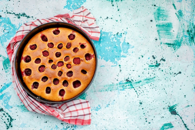 Top view of delicious berry cake baked and yummy inside pan on bright, cake biscuit dough fruit berry sweet