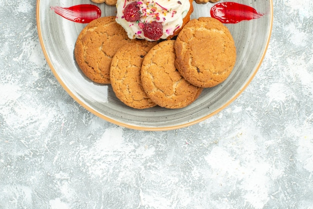 Top view delicious biscuits with cookies and cream cake on white desk sweet biscuit cookies sugar tea cake