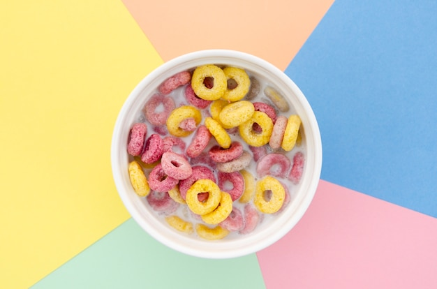 Top view delicious bowl of fruit cereal loops