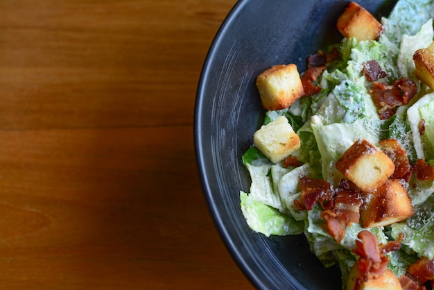 Top view of delicious caesar salad with croutons