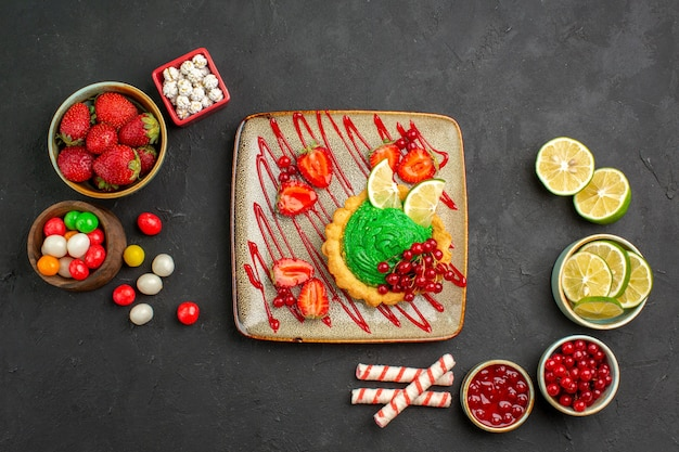 Top view delicious cake with candies