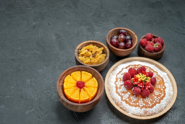 Top view delicious cake with raspberries and fruits on the grey background cake pie fruit berry sweet cookie