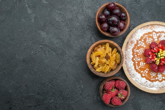 Top view delicious cake with raspberries and fruits on grey background sweet cake pie fruit berry cookie