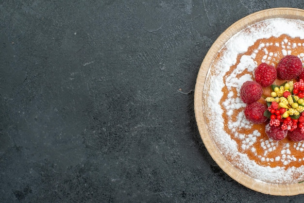 Top view delicious cake with sugar powder and raspberries on the grey background pie cake fruit berry sweet cookie
