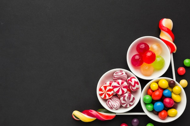 Top view delicious candies with copy space