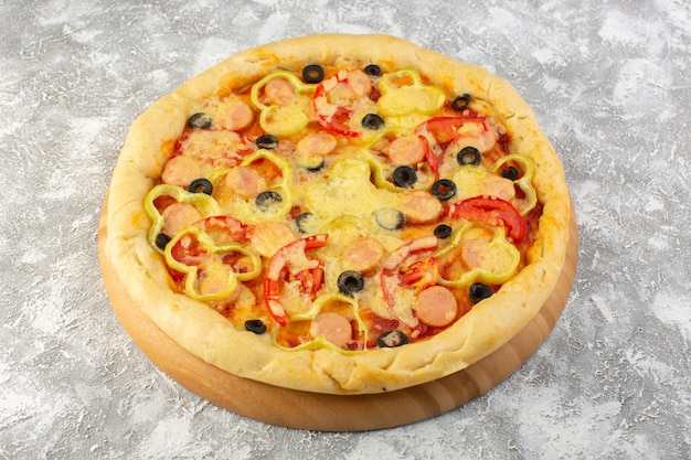 Top view delicious cheesy pizza with olives sausages and tomatoes on the grey background fast-food italian dough food meal