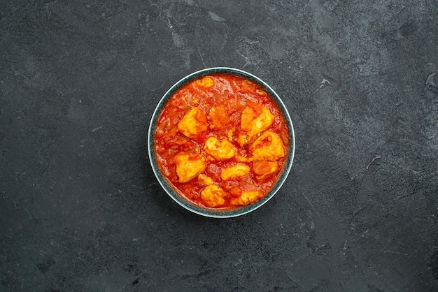 Top view delicious chicken slices with tomato sauce on grey background sauce dish meat chicken tomato