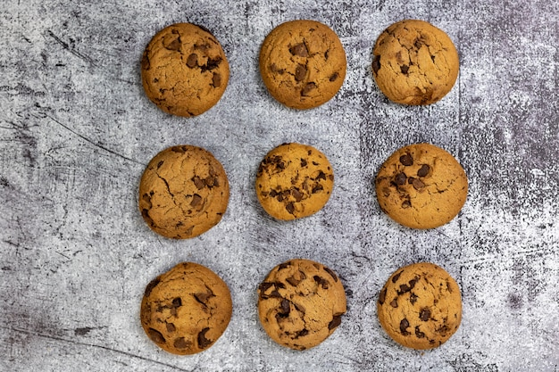 Top view of delicious chocolate chip cookies on a textured surface