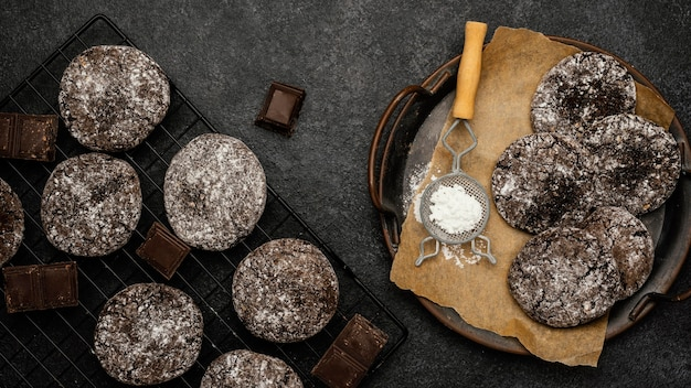 Top view of delicious chocolate cookies with powdered sugar