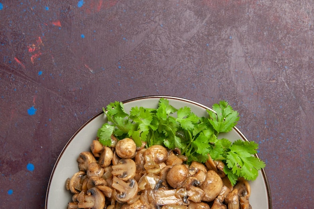 Top view delicious cooked mushrooms with greens on a dark background dish dinner meal wild plant food