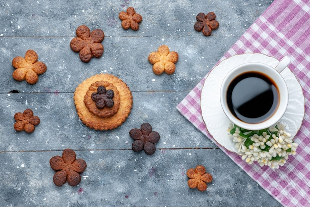Top view of delicious cookies sweet with cup of coffee the grey, cookie sugar biscuit sweet