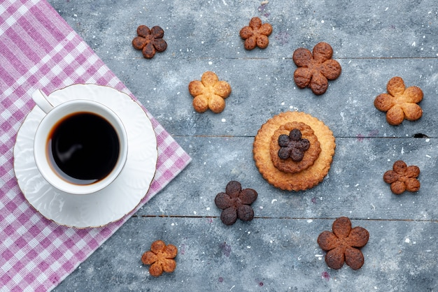 Top view of delicious cookies sweet with cup of coffee the wooden grey, cookie sugar biscuit sweet