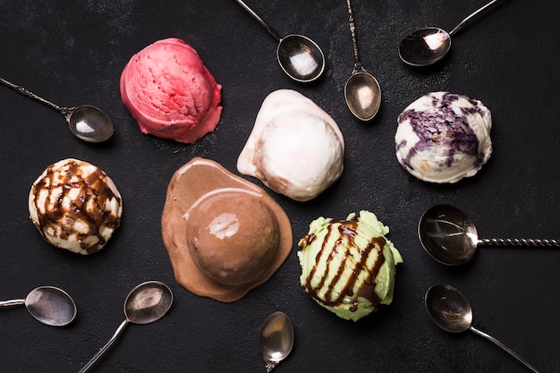 Top view delicious different ice cream scoops with topping