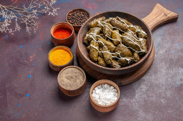 Top view delicious dolma meat dish with different seasonings on the dark background food calorie dinner dish meat Free Photo
