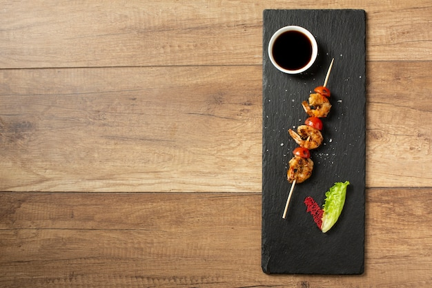 Top view of delicious food on wooden table