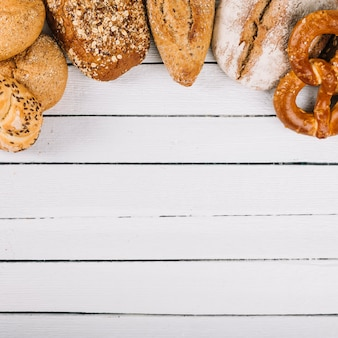Top view of delicious freshly baked bread on wooden background