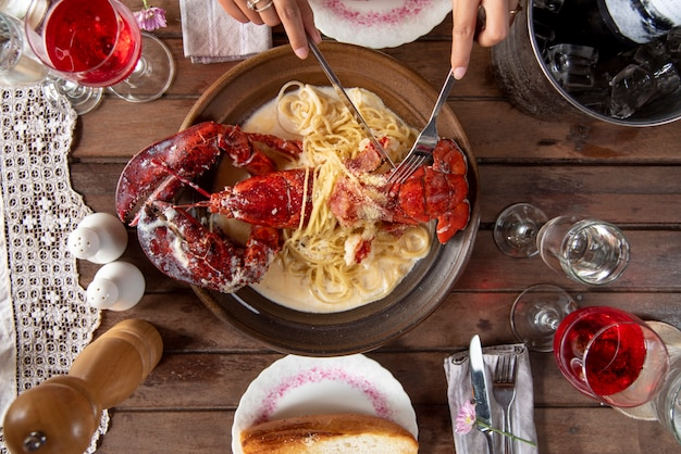 Top view a delicious freshly boiled lobster for dinner set wood table background