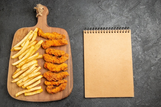 Top view of delicious fried chicken with french fries