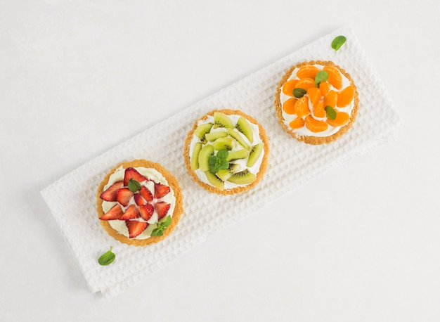 Top view delicious fruit tart line