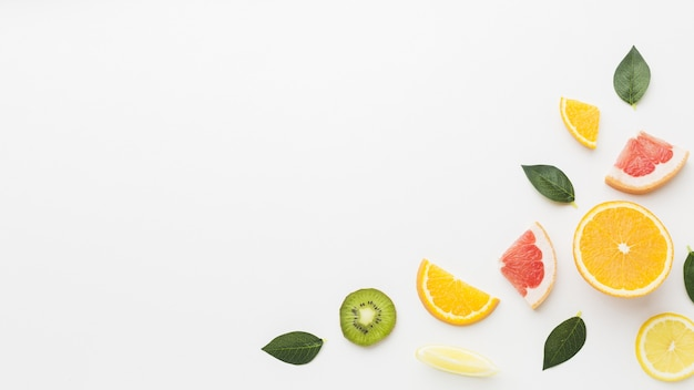 Top view of delicious fruits with copy space