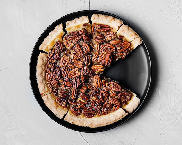 Top view delicious handmade pecan pie on a plate