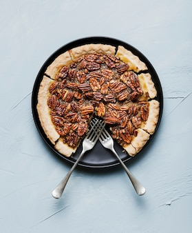 Top view delicious homemade pecan pie with forks