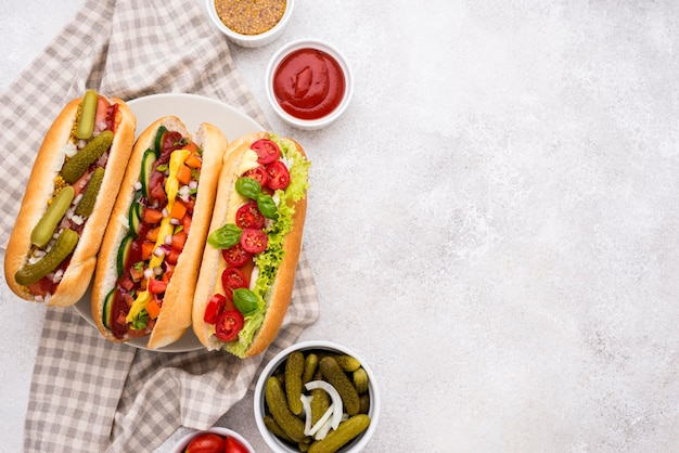 Top view delicious hot dogs frame