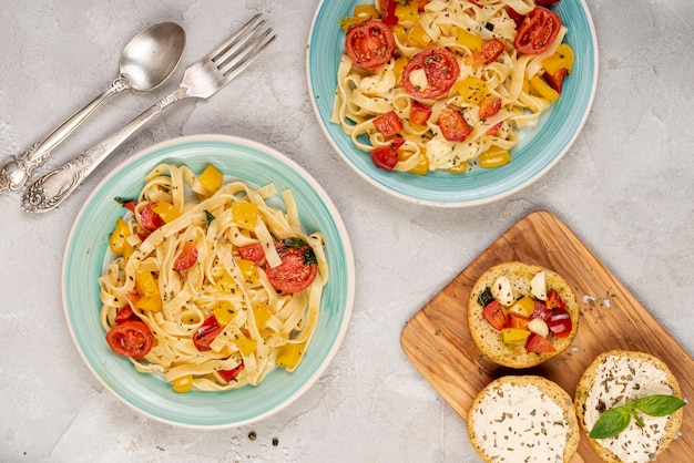 Top view of delicious italian food on plain background