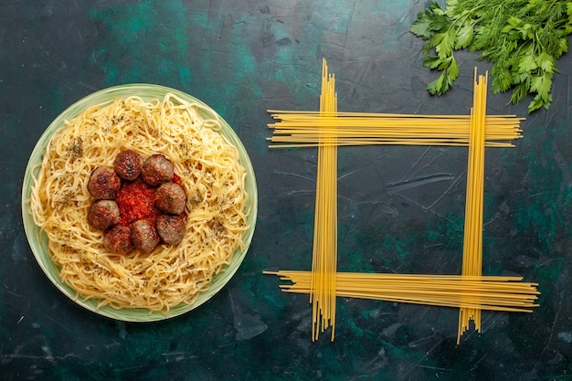 Top view delicious italian pasta with meatballs and tomato sauce on dark-blue background dough pasta meal dish dinner food italy