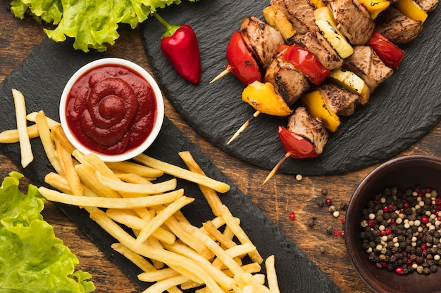Top view of delicious kebab with french fries and ketchup