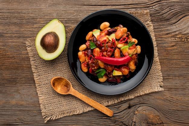 Top view delicious mexican food with avocado