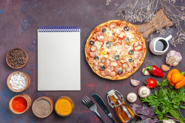 Top view delicious mushroom pizza with cheese olives and seasonings on dark desk pizza meal italian food dough snack