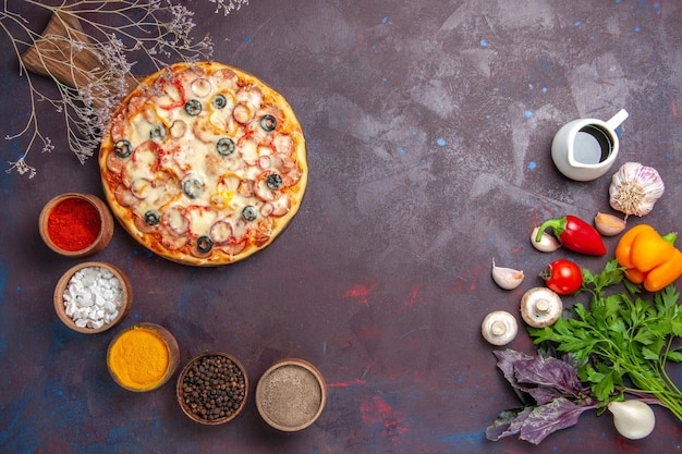Top view delicious mushroom pizza with cheese olives and seasonings on the dark surface dough food pizza meal italian